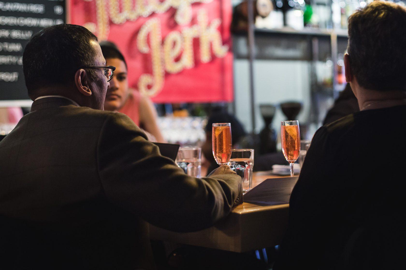 Friends casually having beer at a bar
