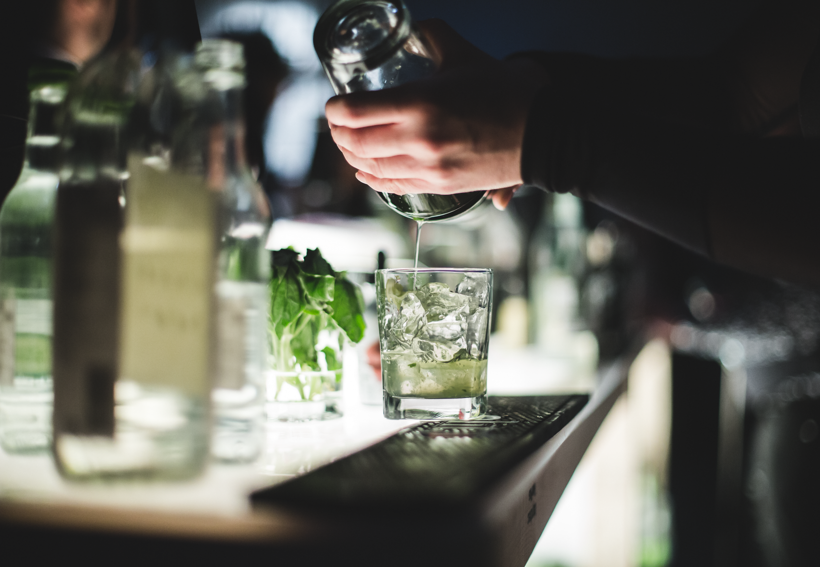 Bartender making a ice cold alcoholic beverage