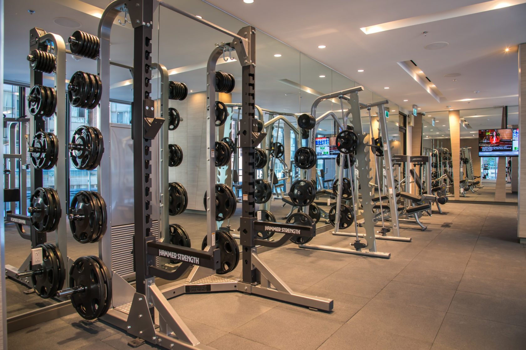 The Livmore amenities - gym / fitness area with standalone weights